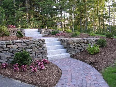 Professional landscaping services landscape solutions for Stone wall landscaping ideas